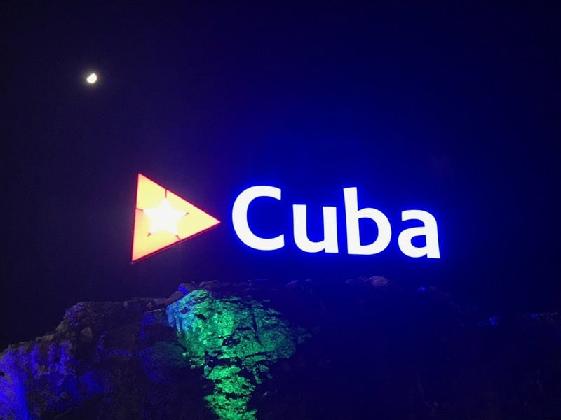 The sign lit up on the hillside above where Avenida 23 meets the Malecón.