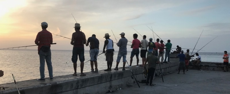 Fishermen on the Malecón, at the entrance to Havana Harbor