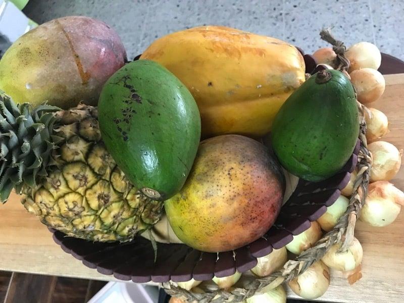 Mango, pineapple, papaya, avocado, and onion from the produce market