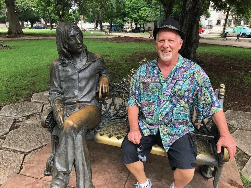 Mark in John Lennon park next to the statue of John Lennon